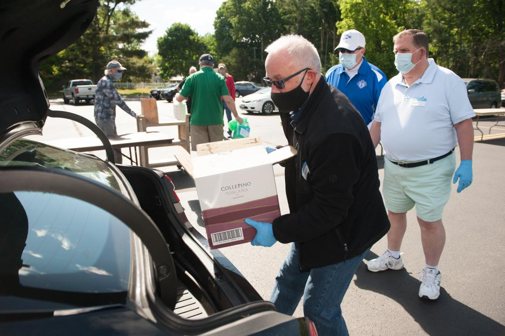 Ed Buckley unloads food donations during St. John of Rochester food drive.