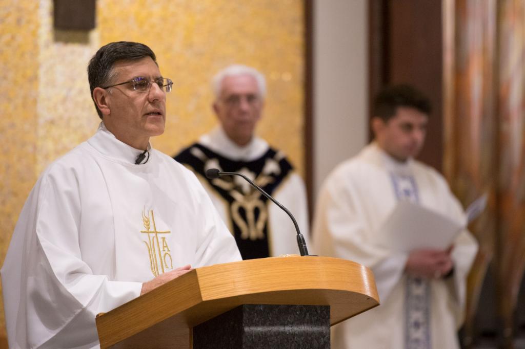 Deacon Marcelo DeRiso leads the congregation in song.
