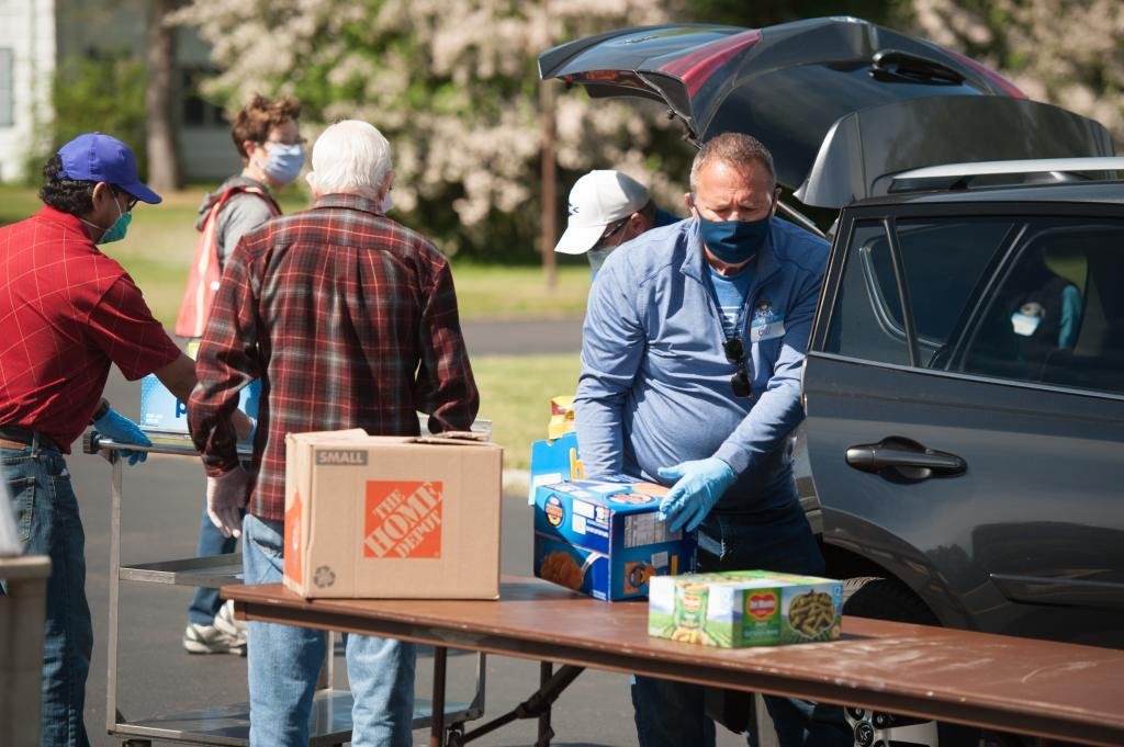 Bill Wayne unloads donations during food drive.