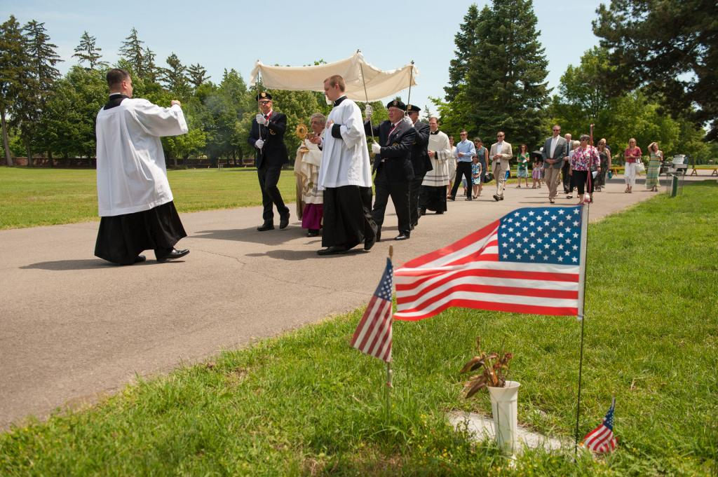 Bishop Matano leads the procession through the cemetery.