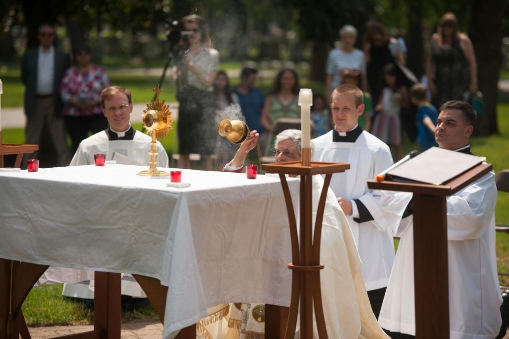 Bishop Matano censes the monstrance and altar.