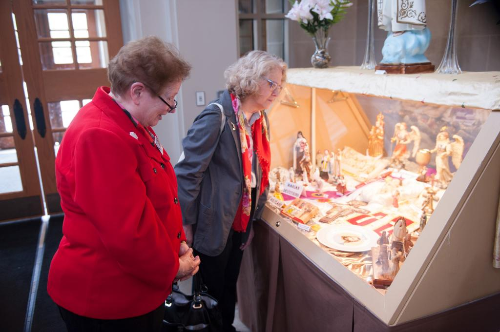 Sister of St. Joseph Sue Hoffman (left) and Candice Johnson look at a cultural display at the cathedral.