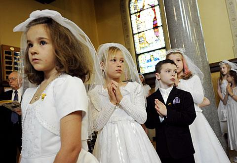 First Communicants line up prior to the Mass.