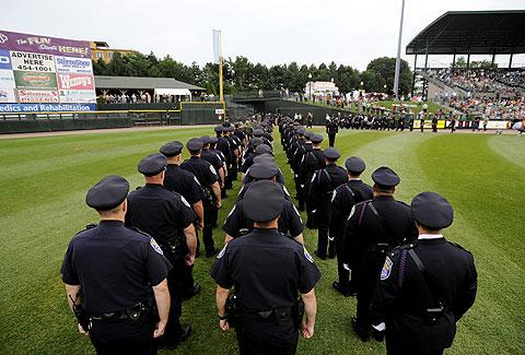 Rochester police officers line up on the field.