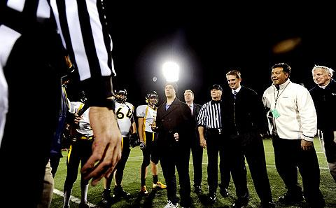 RPD officer Anthony DiPonzio tosses the opening coin.