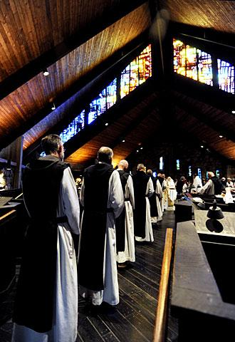 Monks line up to take Communion.