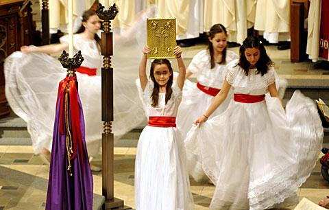 Liturgical dancer Mariana Menting carries the Book of the Gospels.
