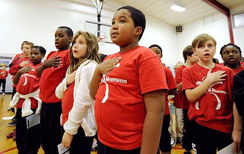 Students recite the Pledge of Allegiance.