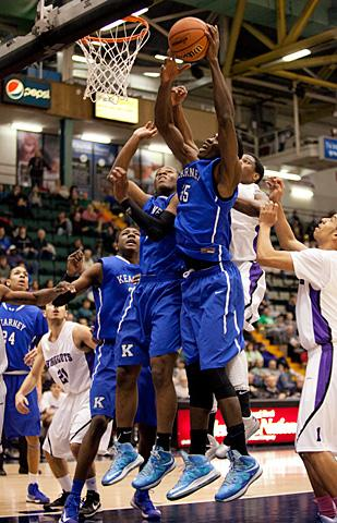 Kearney players fight for a rebound.
