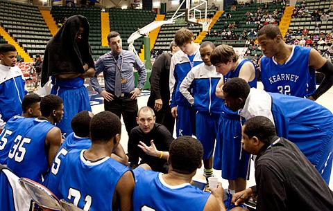 Coach Jon Boon speaks with the team during a time-out.