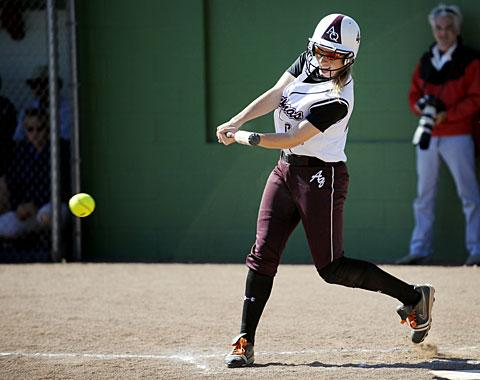 Caileen Sennett makes contact at the plate.