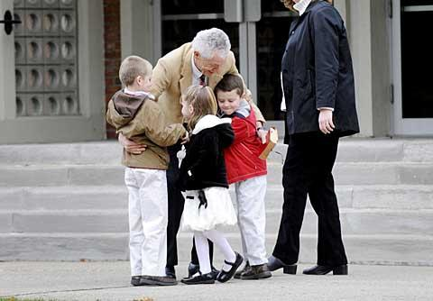 Joe Madonia greets his grandchildren before the Mass.
