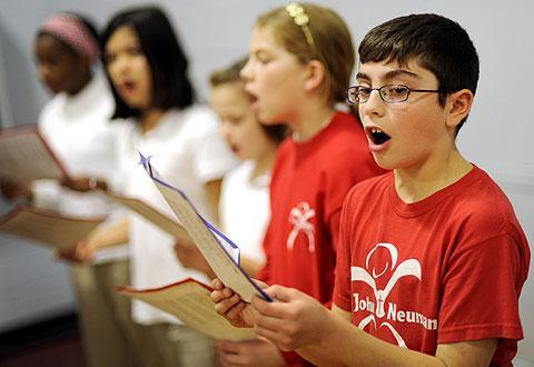 Sixth-grader Nicholas Bruno and his classmates sing.
