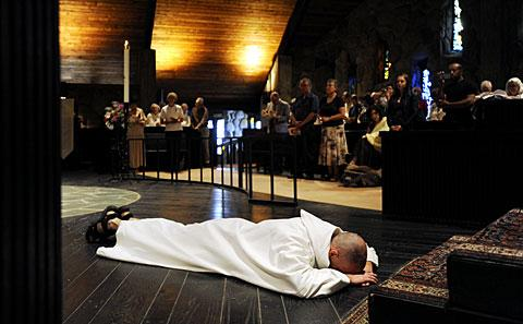 Brother Isaac Slater prostrates himself.