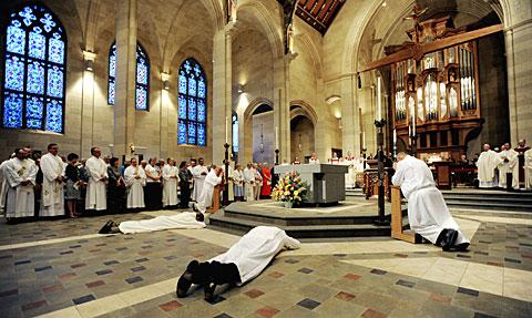 Deacon candidates prostrate themselves before the altar.