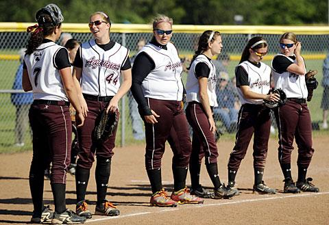 Players line up before taking the field.