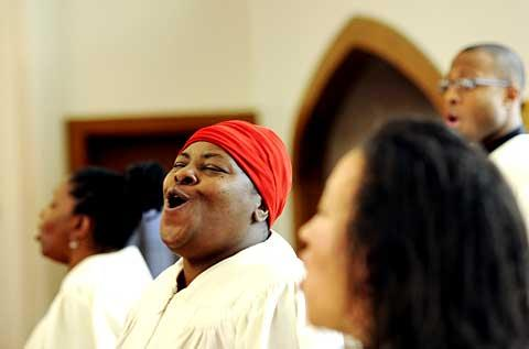 Marilyn Bellamy performs with the St. Bridget's Gospel Choir.