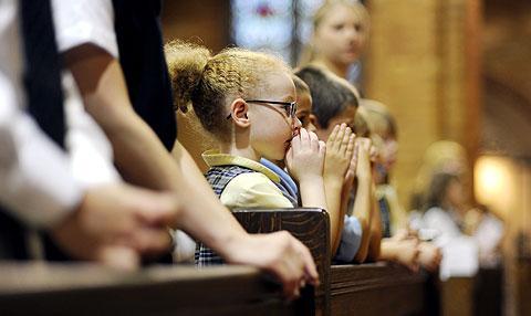 St. Mary kindergartner Leah Batterson prays.