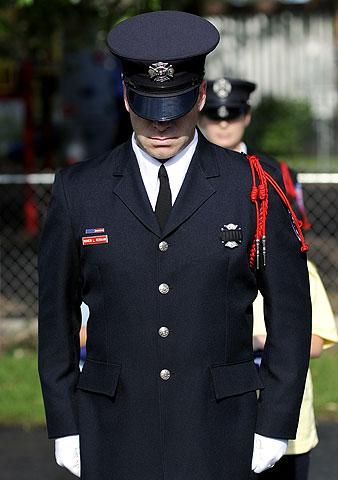 Roger Rebman leads the RFD honor guard.