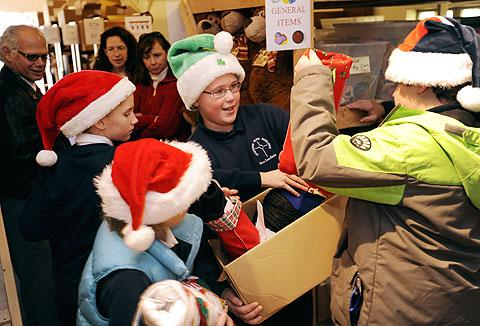 James Schnell (center) gets help unpacking a box.