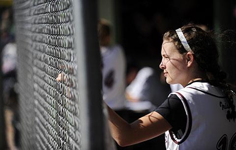 Shortstop Paige Monachino watches from the dugout.