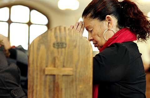 Immaculate Conception parishioner Genna Miller prays.