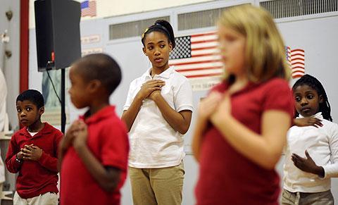 Fifth-grader Nya Robinson (center) performs for veterans.