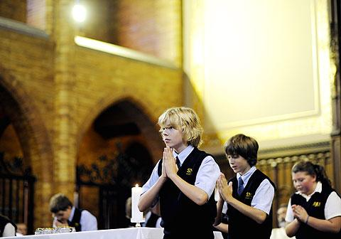 St. Mary student John Reston and classmates sing.