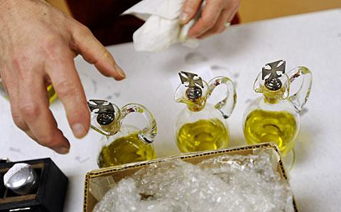 Glass vessels with cross stoppers belong to St. Alphonsus Church.