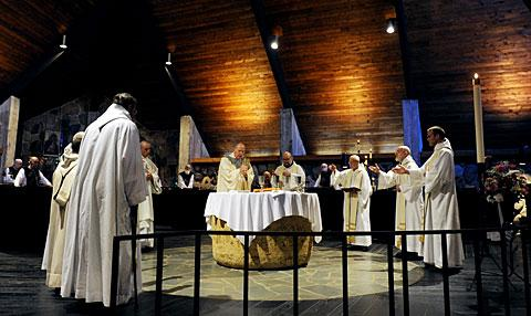 Monks surround the altar as Bishop Clark celebrates Mass.