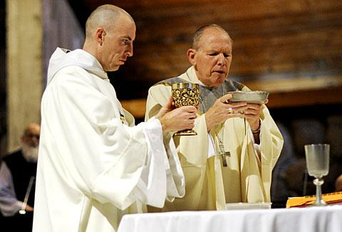 Brother Slater (left) and Bishop Clark at the altar.