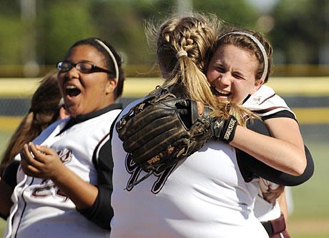 Paige Monachino (right) hugs Gabrielle Sereika after the win.