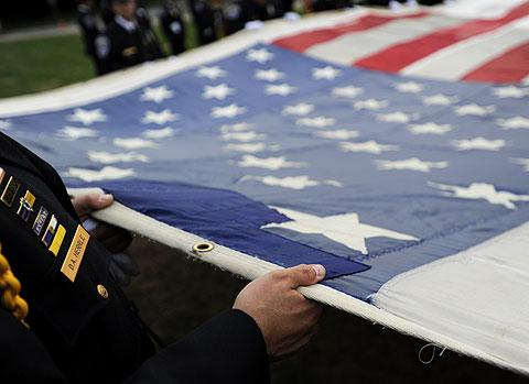 The flag has been stitched together since its near destruction.