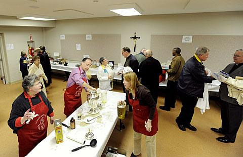 Parishioners and clergy collect their oils from the basement.