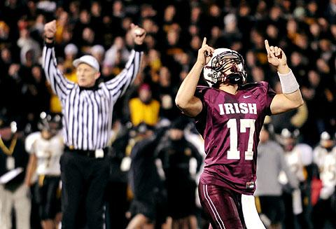 Aquinas QB Cory Benedetto celebrates after a touchdown.