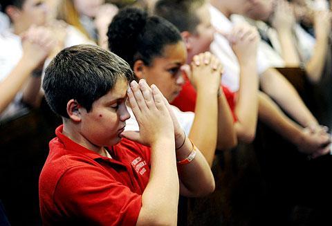 St. Francis-St. Stephen student Nick Gentner prays.