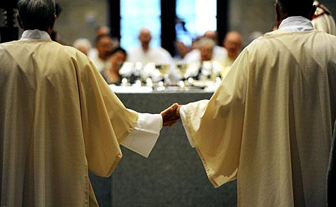 Newly ordained deacons join hands.