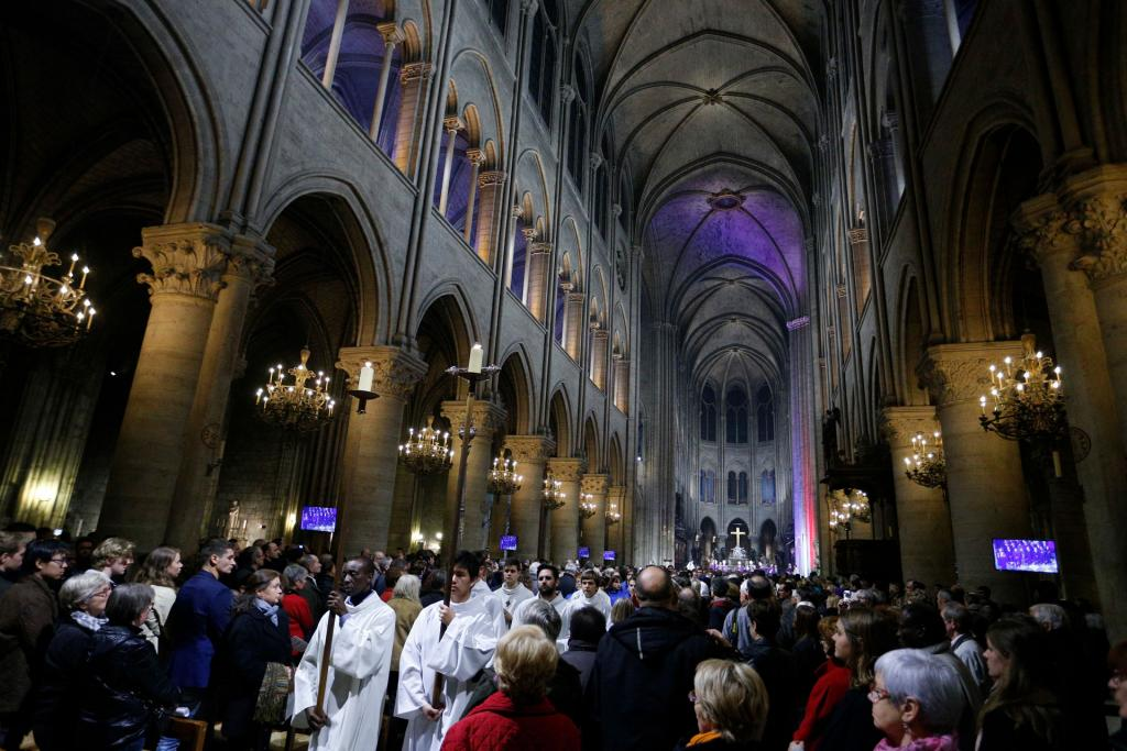 Altar servers process out after Mass at Notre Dame Cathedral in Paris Nov. 15, 2015. (CNS photo by Paul Haring)