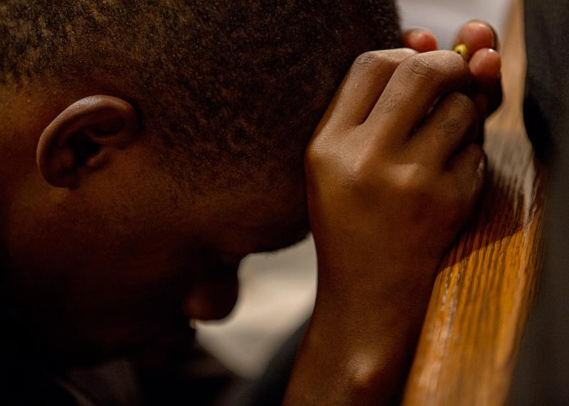 Christian Amah, a seminarian at St. Joseph's Seminary in Yonkers, prays during an evening prayer service at St. Patrick's Cathedral.