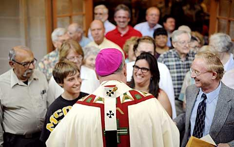 People line up to meet Archbishop Dolan after the Mass.