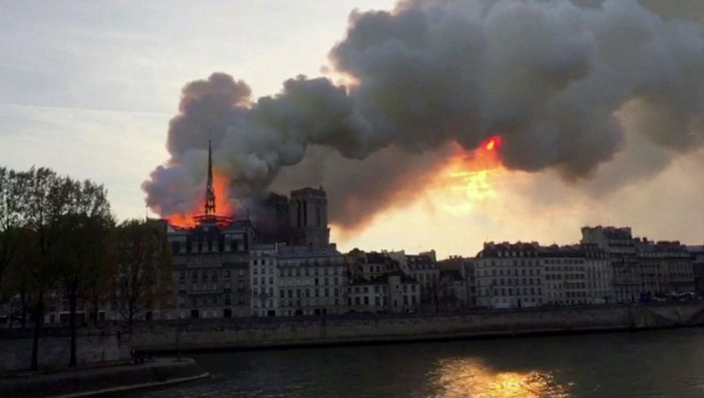 Flames and smoke billow from the Notre Dame Cathedral after a fire broke out in Paris April 15. (CNS photo by Reuters TV)