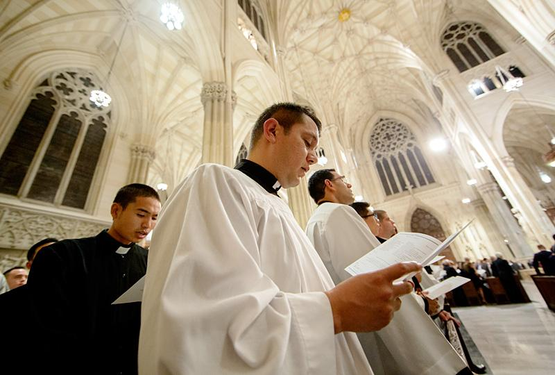 Seminarians from St. Joseph's Seminary in Yonkers sing during the evening prayer service at St. Patrick's Cathedral.