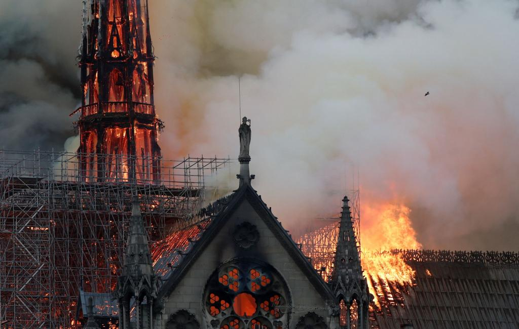 Flames and smoke billow from the Notre Dame Cathedral after a fire broke out in Paris April 15. (CNS photo by Benoit Tessier, Reuters)