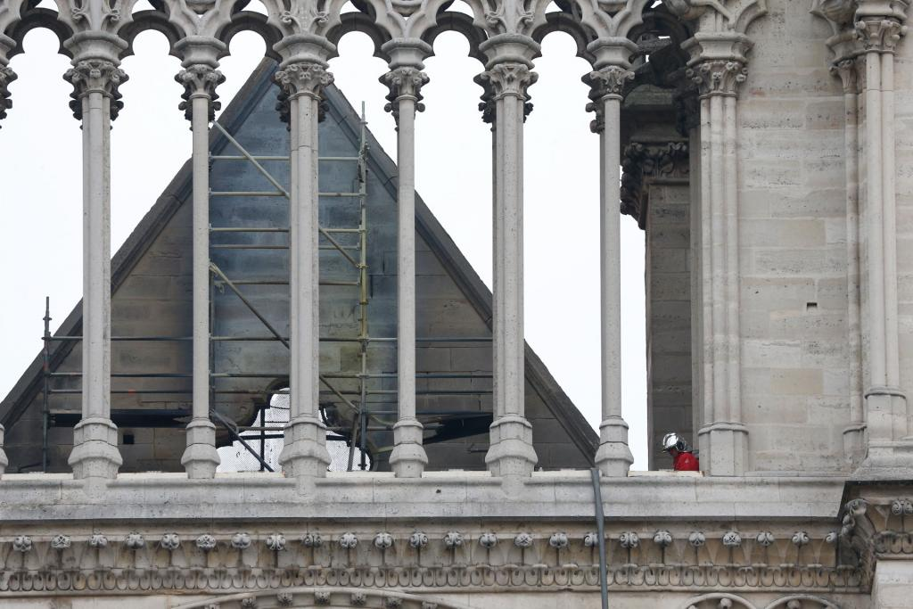 A firefighter inspects Notre Dame Cathedral April 16. (CNS photo by Paul Haring)