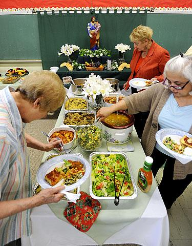 Parishioners partake in the meatless buffet.