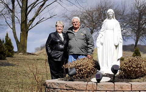 Sharyon and Arnold Dueppengeisser and their Mary statue.