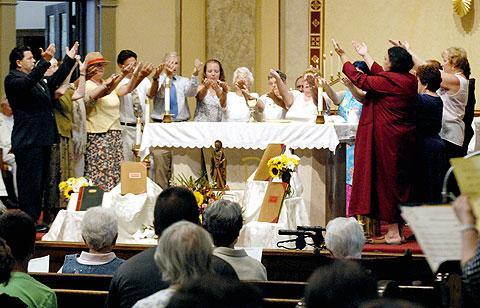 Parishioners dress and prepare the altar.