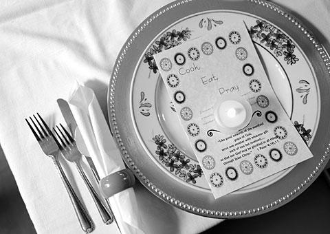 A place setting and program await a guest.