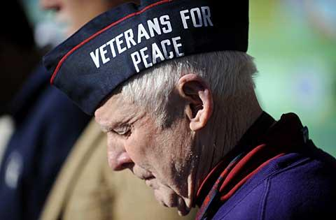 World War II veteran George McVey bows his head.