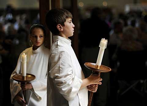 Altar servers Cecilia Hoskins (left) and Matthew Clements.